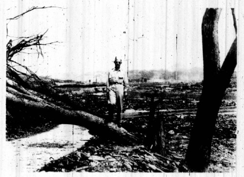 American physicist Robert Serber at Nagasaki, September 1945, showing a tree snapped by the blast 4,000 feet from Ground Zero.