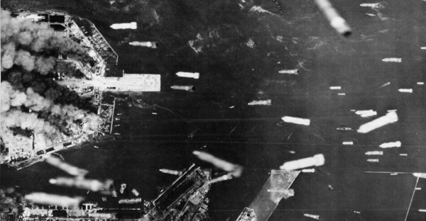 Incendiary bombs drop over Osaka, July 1945