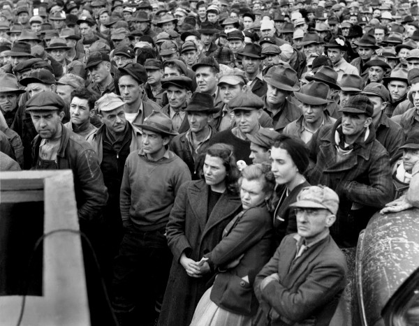 "A 1944 ""Stay on the job"" rally at J.A. Jones Construction Co. in Oak Ridge. The workers seem a little unimpressed. Source."