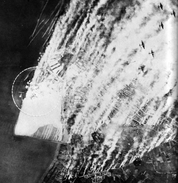 "German smokescreen use at Wilhelmshaven in June 1943. Caption: ""Despite a smoke screen, 168 B-17s of the Eighth Air Force attacked Wilhelmshaven on 11 June. There are three lines of generators to windward of the area covered when the wind is in the north, as it was in this case. Generator boats are at the upper left. Despite the extent of the smoke screen hits are observed inside the circle..."" Source: USAAAF IMPACT magazine, vol. 1, No. 5, August 1945, page 18."