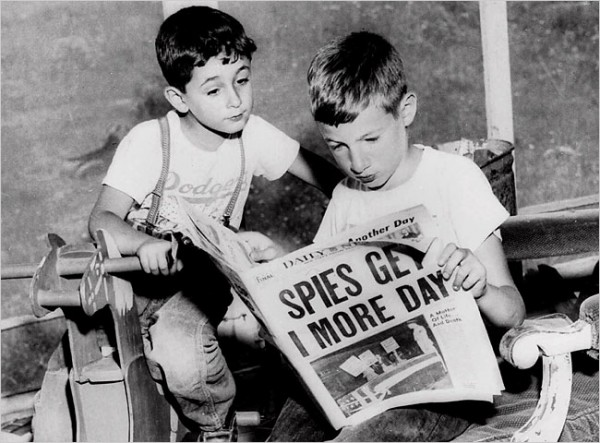 """Ethel and Julius Rosenberg's sons, Robert, 6, left, and Michael, 10, looking at a 1953 newspaper. They still believe their parents did not deserve to die."" Photo from the Associated Press, via the New York TImes"