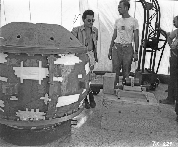 "Louis Slotin and Herb Lehr at the assembly of the Trinity ""Gadget."" Source: Los Alamos National Laboratory Archives, photo TR-229."
