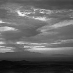 The late stages of the Trinity cloud as viewed from many miles distant, as it becomes a shifting, twisting column of radioactive dust. Obtained from Los Alamos National Laboratory.