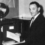 Richard G. Hewlett, posing in 1958 with the Bush-Conant document collection.