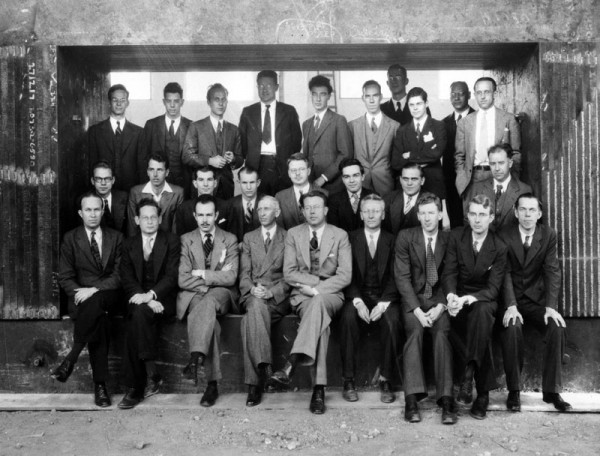 The scientific staff of the University of California Radiation Laboratory with magnet of unfinished 60-inch cyclotron. Lawrence is front and center. Oppenheimer stands in back. Credit: Emilio Segrè Visual Archives.