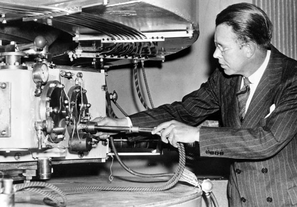 Lawrence and the Machine (or, at least, one of them). I like the idea that Lawrence was doing his research wearing a full suit and tie. Credit: Emilio Segrè Visual Archives.