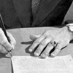 "The hands of the censor: Charles L. Marshall, Director of Classification, declassifying a document as part of the Atomic Energy Commission's 1971-1976 ""declassification drive."" Source: Nuclear Testing Archive. Click for the uncropped version."