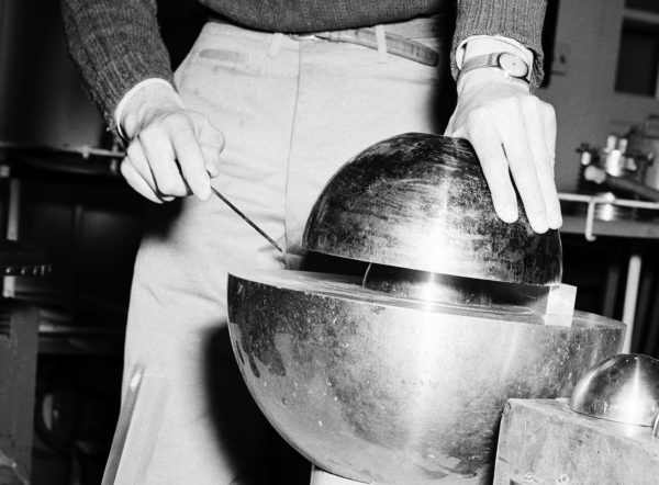 "Close-in shot on the Slotin accident re-creation. The beryllium tamper is on top; the plutonium core is the smaller sphere in the center. Notice in this particular shot, they have a ""shim"" on the right. Slotin removed the shim right before his fatal slip."