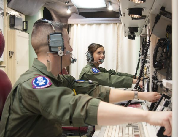 """1st Lt. Pamela Blanco-Coca, 319th Missile Squadron missile combat crew commander, and her deputy commander, 2nd Lt. John Anderson, simulate key turns of the Minuteman III Weapon System Feb. 9, 2016, in a launch control center in the F.E. Warren Air Force Base, Wyo., missile complex. When directed by the U.S. President a properly conducted key turn sends a 'launch vote' to any number of Minuteman III ICBMs in a missileer's squadron, with two different launch votes enabling a launch. (U.S. Air Force photo by Senior Airman Jason Wiese)"""
